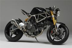 NCR_Ducati_ONE_SHOT_09. Titanium frame, carbon fiber wheels and other bits, stroker Ducati EVO (1100 to 1200), 100+ lbs lighter (around 280 lbs) than a stock Monster which is already pretty light to begin with. $69,900