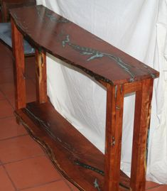 Mesquite sofa table using turquoise paste and turquoise stones on Etsy, $1,060.00