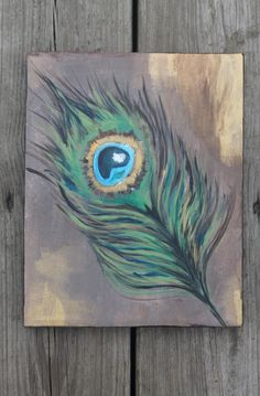 Acrylic peacock feather on canvas via Etsy $30