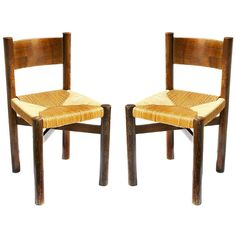 """Pair of """"Méribel"""" chairs by Charlotte Perriand"""