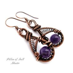 Handmade woven wire copper earrings. Solid copper wire and Amethyst beads were used to form these earrings. The ear wires are also solid