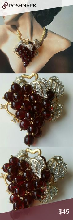 1980's Vintage Nolan Miller Bordeaux Grapes Brooch Beautiful brooch. Very good to excellant vintage condition. Simulated garnet glass grapes arranged in a cluster, pave and prong set clear rhinestones. Goldtone construction.  Hall Marked Nolan Miller. 2 1/4 x 2 1/8. Vintage Jewelry Brooches