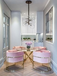 Pink velvet chairs in small london apartment with marble kitchen. velvet furniture. home decor and interior decorating ideas. dining room