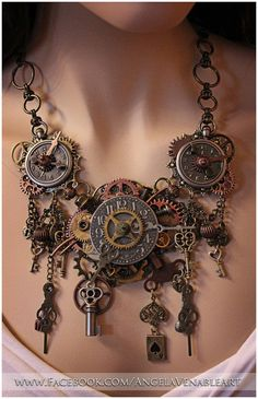 This is practically a wearable clock.  It puts a typical pendant to shame, and would fantastically top a ball gown or corset top.  #steampunk