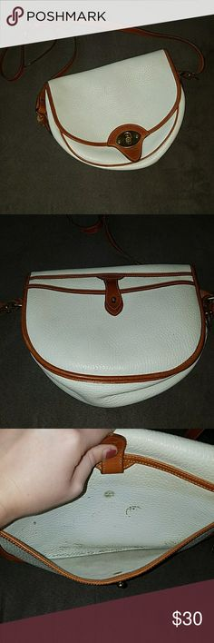 *SALE* Vintage Dooney & Bourke Bag (HAS FLAWS) Preloved Vintage Leather Dooney & Burke all weather leather crossbody bag. This bag has many flaws. The inside has many pen marks & stains and a seam in torn on the inside as noted in the pictures. The hardware has tarnish and the outside leather has some small scuffs/stains as well. I tried taking good pictures of all the imperfections. Please do not buy this bag unless you are ok with its condition and flaws!! I'm happy to answer any questions…
