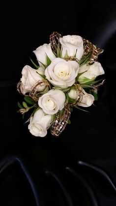 Wrist corsage of white spray roses and gold bling