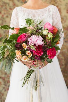 berry toned bouquet - photo by Sarah McKay Photography http://ruffledblog.com/modern-romantic-wedding-with-freixenet