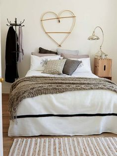 Layer your bed with textured wool and mohair blankets and soft cotton bedding for a very cosy night's sleep.