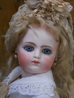 "*RARE EARLY PERIOD FRENCH BISQUE BEBE ~ by: Gaultier ~ Fine and pale bisque pressed swivel head w/wonderful light blue glass paperweight inset eyes w/fine spiral threading....w/rare block letter marks at head; F. 5 G. // 15""., France c.1878-1780"