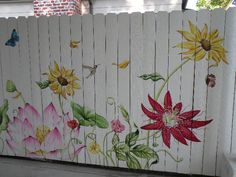 I love the beautiful mural painted by Renee Fox.  It brings beauty and an upbeat whimsy to a previously white boring fence.