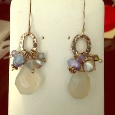 Pale blue chalcedony cluster drop earrings Pretty pale blues chalcedony faceted teardrops with clusters of various gems, pearls and Swarovski crystals. Antiqued sterling silver 1 3/4 inches long, French hook wires. Emily designs Jewelry Earrings
