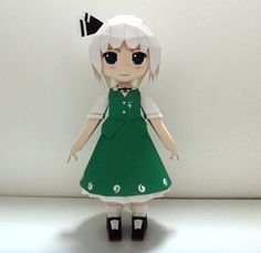 Created by Japanese designer Nobi , this is the  paper model version of Youmu Konpaku , a half-human half-phantom who lives at Hakugyokurou...