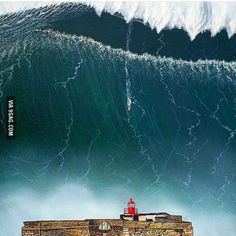 A Perfect Storm hits Nazaré, Portugal . not only that but the surfing record was recorded here . you can see Garrett Mc Namara on his board riding down the face of the huge wave in Portugal No Wave, Surf Mar, Wind Surf, Big Wave Surfing, Huge Waves, Giant Waves, Windsurfing, Surfs Up, Ocean Waves