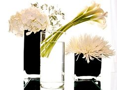 Hydrangea, Calla Lillies, and Spider Mums; glass could be blue or navy