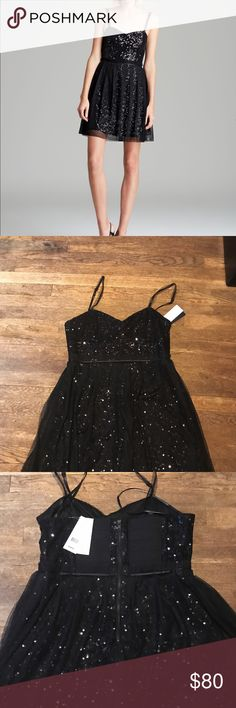 French Connection Spectacular Sparkle Dress Flirty LBD by French Connection. This black sequin dress has a mesh like tulle overlay and an exposed back zipper. It is fitted around the bust and has a bit fuller skirt.  Perfect little occasion dress❤️ French Connection Dresses Midi