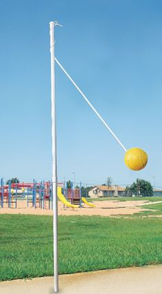 "For a very short time I remember having a Tetherball pole at my elementary school. I wasn't one to ever play but I would watch. I believe two or more people hit the ball on the string as hard and fast as you could and have it spin around the pole. And if you ""accidently"" hit someone with the ball — you got bonus points!!"