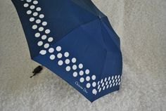 Luxurious vintage 80s navy blue umbrella with white polka dot print. Made by Christian Dior.