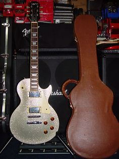 1997 GIBSON EPIPHONE SILVER SPARKLE LES PAUL GUITAR - cool looking Les Paul, simple and not simultaneously.