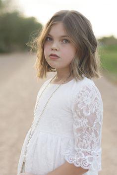 She's a tornado with pretty eyes and a heartbeat #texasgirl #phoneix #arizona #bsteelephotography #childmodel #kidmodel #shorthair #bluegreeneyes #flowergirldress