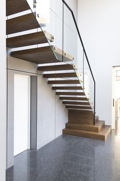 Stairs | Contemporary | Floating | Cantilevered | Stained | American Oak | Glass Balustrade | Handrail | Stainless Steel | Feature Steps | Architecture | Interior Design | Polished Floors | Modern