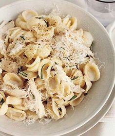 Parmesan Pasta With Chicken and Rosemary 12 ounces orecchiette (about 3 cups) 1 2- to 2 1/2-pound rotisserie chicken 2 tablespoons chopped fresh rosemary 3/4 cup grated Parmesan (3 ounces) kosher salt and black pepper