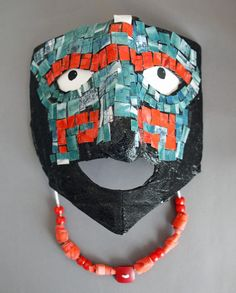 Teotihuacan inspired mask lesson idea. - We could mosaic this with torn paper.
