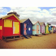 Bright Vibrant Coloured Beach Huts With A Moving Home