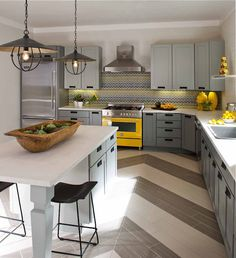 A little 'happy kitchen' inspiration. Combines my favs...grey, yellow accents, chevron pattern, & wood!