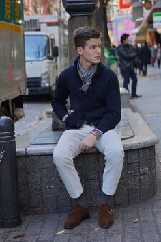 Shop this look for $337:  http://lookastic.com/men/looks/chinos-and-double-monks-and-socks-and-scarf-and-shawl-cardigan/2107  — Light Blue Chinos  — Dark Brown Suede Double Monks  — Navy Socks  — Grey Silk Scarf  — Navy Shawl Cardigan