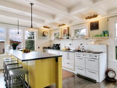 like the openness of this kitchen...the big island, the vintage stove, the open shelving, the coffered ceiling