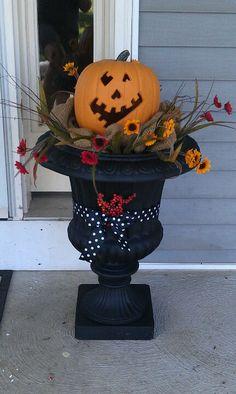 Porch decor...with just a plain pumpkin. No jack-o-lanterns.