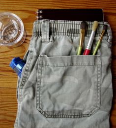 Make a field bag from recycled clothing. This is great for a few reasons: 1) it's a way to re-use old clothes; 2) you make something totally fun and useful; and 3) I'm pretty sure between me and my oldest kid, we could manage to make it! -RW