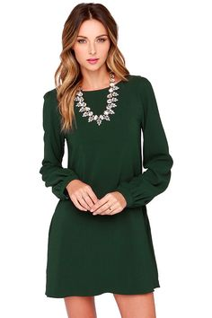 You'll be primed and ready in the Perfect Situation Dark Green Long Sleeve Shift Dress when everything starts falling into place! This woven poly dress has a casual shift shape, accented by a rounded neckline and long sleeves with lightly puffed shoulders. Sleeves end with shining gold button tabs on the fitted wrist cuffs. Hidden side seam pockets.