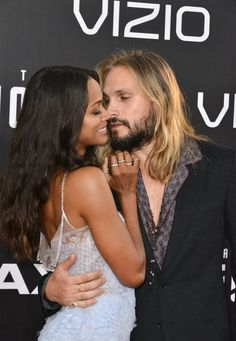 Zoe Saldana is back in the arms of her newly nationalized husband, Marco Perego on the red carpet.