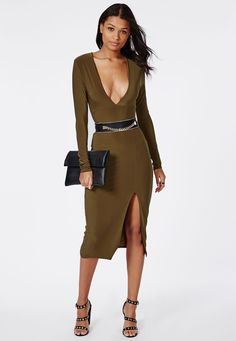 Stun all this season in this chic feminine long sleeve khaki midi dress with side split running up the left leg. The deep plunging V neckline and slinky fabric will give you a standout silhouette in this dress. Style this up with strappy he...