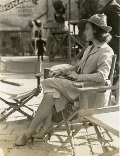 1930s Carole Lombard sitting on a movie set suit jacket hat shoes snapshot photo movie star