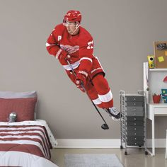 Put your passion on display with a giant Dylan Larkin - Life-Size Officially Licensed NHL Removable Wall Decal Fathead wall decal!