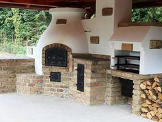 Outdoor kitchen with oven, pizza oven, BBQ, and traditional stove ...