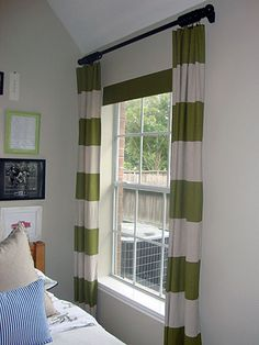 DIY horizontal stripe curtain panels; links up to tutorial for the board that hides a roller shade