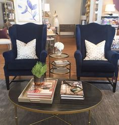 Ooooh how we love a good wing chair! If modern, yet classic, is what you're searching for than you'll find it in our New Navy Wing Chair. She's quietly traditional with that certain something that makes her a showstopper. With a plushy velvet upholstery and stately brass nail head, you'll be under her curvy spell...