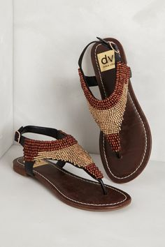 Brown thong sandals with beading.
