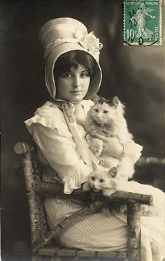 Girl with kitty from the turn of the 20th cent