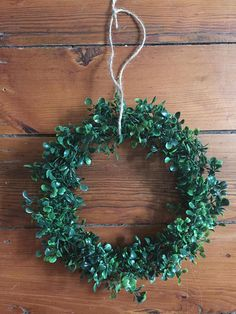 Adorable 10 Faux Boxwood Wreath. This wreath is a bigger option of the 8 wreath that is also listed. Comes with twine for hanging and is a wonderful farmhouse accent to any wall, picture frame, chalkboard, door, etc! Message me for custom orders! ***NOTE ABOUT SHIPPING*** Etsy