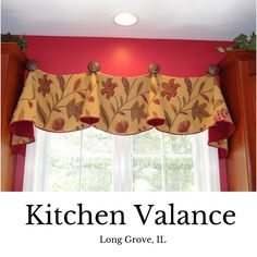 Fabulous valance hung by decorative medallions.