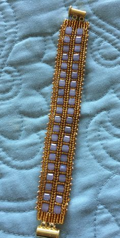 This bracelet is a pattern I found on the internet many years ago.  I just love this pattern , I have made a lot of bracelets using thi...