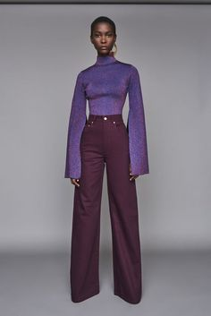 Solace London Nora Jean Aubergine from Fall Winter The classic five-pocket jean updated with flared legs and a super high waist. Fashion Week, Look Fashion, Runway Fashion, Autumn Fashion, Womens Fashion, Fashion Design, Fashion Trends, 70s Black Fashion, Fashion 1920s