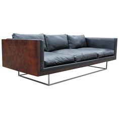 Stunning Milo Baughman Burl Case Sofa | From a unique collection of antique and modern sofas at https://www.1stdibs.com/furniture/seating/sofas/