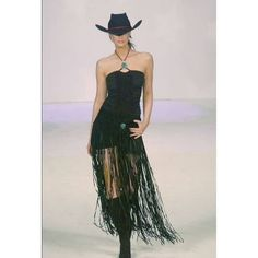 """Pat Dahnke's fabulous long fringe suede hipster belt!  Talk about a statement piece!  Beautiful lines and a clean, chic look! Raw cut edges and simple velcro closure makes this a winner over pants, jeans, a dress or shorts!  A bold accessory that can change the look of the simplest outfit! Choose from brown or black suede.  Each has a beautiful turquoise magnet focal.  Total length is approx. 38"""" including fringe.  Waist on the size small is approx. 30""""."""