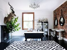 Large black and white bathroom with glamorous details