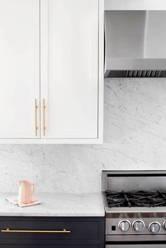 brass, marble, and other current-day classics in a remodeled kitchen!